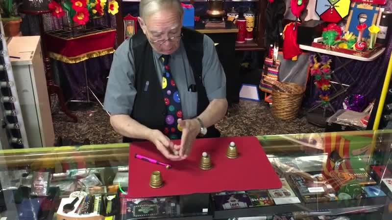 """Doc Grimes performing his guerrilla"""" cups and balls"""