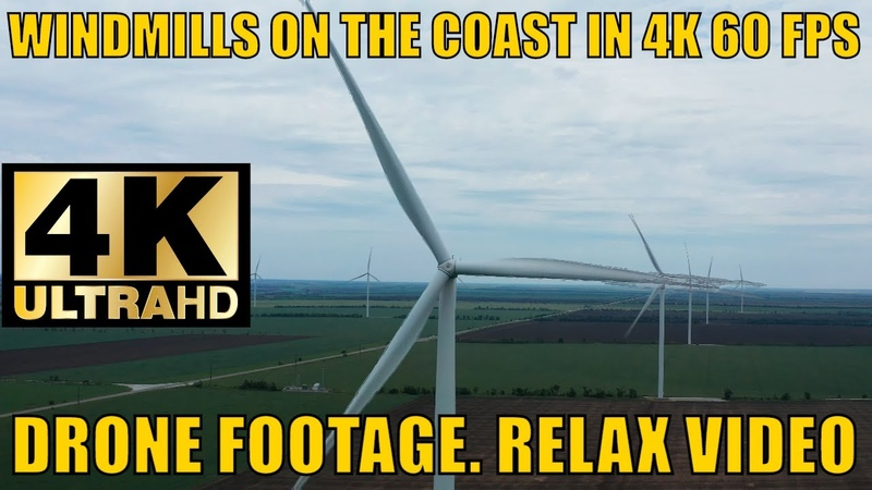 WINDMILLS ON THE COAST IN 4K 60 FPS DRONE FOOTAGE RELAX VIDEO